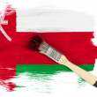 Oman flag painted with brush over it - Stock Photo