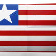 Stock Photo: Liberia. Liberiflag painted on simple paper sheet