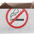 Stock Photo: No smoking sign painted on carton box or package