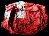 Tonga flag painted on crumpled paper on black background — Stock Photo