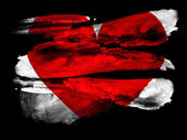 Red Heart symbol painted on black textured paper with watercolor — Stock Photo