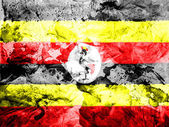 Uganda flag painted dirty and grungy paper — Stock Photo