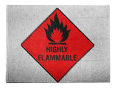 Highly flammable sign drawn on painted on carton box — Stock Photo