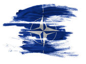 NATO symbol painted on painted on white surface — Stock Photo