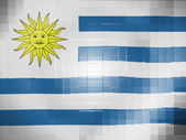 Uruguay flag on wavy plastic surface — Stock Photo