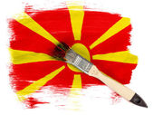 Macedonia flag painted with brush over it — Stock Photo