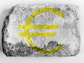 Euro currency sign painted on painted on brick — Stock Photo