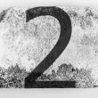 2. Two number painted on brick - Stock Photo