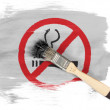 No smoking sign drawn at painted with brush over it - Stock Photo