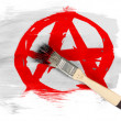 Stock Photo: Anarchy symbol painted n painted with brush over it