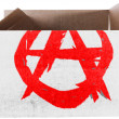 Stock Photo: Anarchy symbol painted on carton box or package