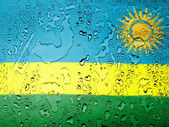 Ruanda flag covered with water drops — Stock Photo