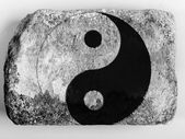 The Ying Yang sign painted on painted on brick — Stock Photo