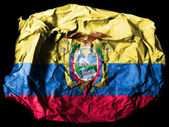 Ecuador flag painted on crumpled paper on black background — Stock Photo