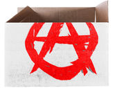 Anarchy symbol painted on carton box or package — Stock Photo