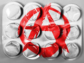 Anarchy symbol painted n painted on tablets or pills — Stock Photo