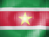 Surinamese flag on wavy plastic surface — Stock Photo