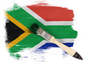 South African flag painted with brush over it — Stock Photo