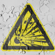 Explosive sign drawn on covered with water drops — Stock Photo #23470036