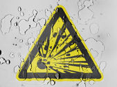 Explosive sign drawn on covered with water drops — Stock Photo