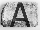 A letter painted on brick — Stock Photo