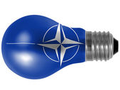 NATO symbol painted on painted on lightbulb — Стоковое фото