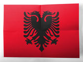 Albania. Albanian flag painted on simple paper sheet — Stock Photo
