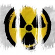 Stock Photo: Nuclear radiation symbol painted on painted with 3 vertical brush strokes on white background
