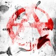 Stock Photo: Anarchy symbol painted n painted on grunge wall