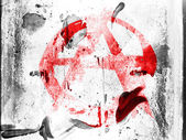 Anarchy symbol painted n painted on grunge wall — Stock Photo
