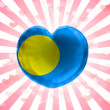 Palau flag painted on glass heart on stripped background — Stock Photo #23491169
