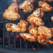 Buffalo wings cooked on grill - Stock Photo