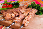Raw kebab on wooden board — Stock Photo