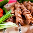 Stock Photo: Raw kebab with onion on wooden board