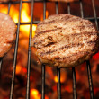 Beef cutlet on grill — Stock Photo