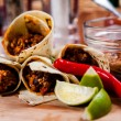 Burrito on wooden board — Stock Photo