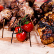 Set of grilled meat on wooden board - Stock Photo