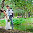 Stock Photo: Groom and Bride in park