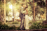 Groom and Bride in a park — ストック写真