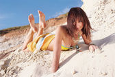Beautiful woman lying down on a beach — Stock Photo