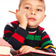 Stock Photo: Boy with books and pencil