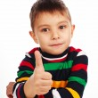 Stock Photo: Smiling little kid with thumbs up sign