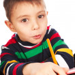 Stock Photo: Boy with book and pencil