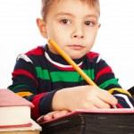 Boy draws a pencil on the album — Stock Photo #18316197