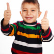 Smiling little kid with thumbs up sign — Stock Photo #18316651