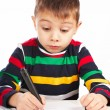 Boy draws a marker on paper — Stock Photo #18317151