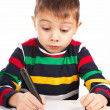 Stock Photo: Boy draws a marker on paper