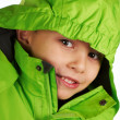 Laughing boy dressed in a warm winter jacket — Stock Photo