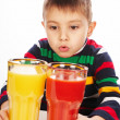 Stock Photo: Boy with tomato and orange juices