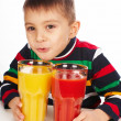 Boy with tomato and orange juices — Stock Photo